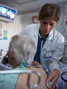 Nurse practitioner caring for older adult patient