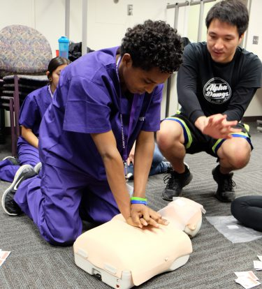 UW Nurse Camper learns CPR on a Simulation Center task trainer.