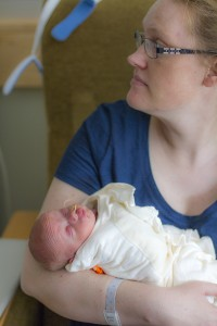 A mother and infant in the UW Neonatal Intensive Care Unit