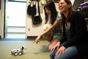 Students in the HEALTH-E lab with robotic pet